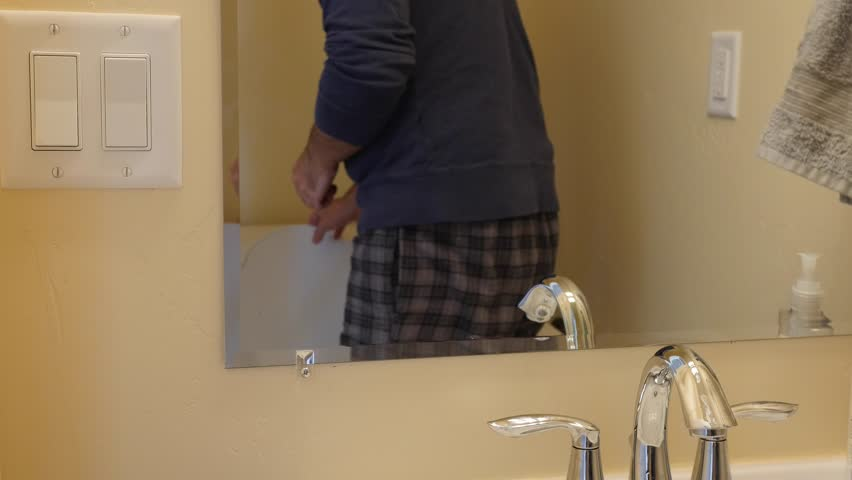 A man washes his hands with soap and water in his home restroom | Shutterstock HD Video #13168418