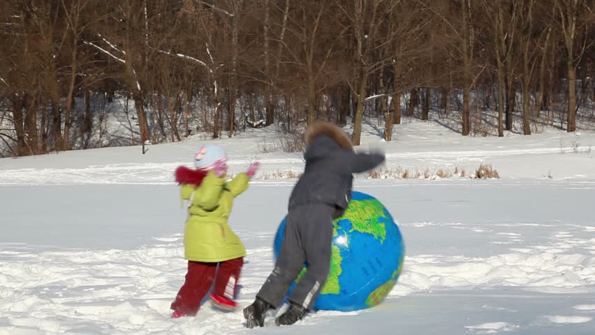 Two Kids Boy And Girl Play With Inflated Ball With Earth Map - Map videos for kids