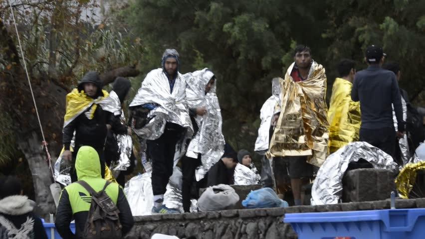 LESVOS, GREECE october 22, 2015: Refugees arriving in Greece in dinghy boat from Turkey at Skala Sykaminia Lesvos