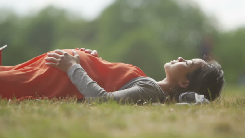 4K Happy pregnant woman relaxing in the park feels the baby kicking. Shot on RED Epic. | Shutterstock HD Video #13178549