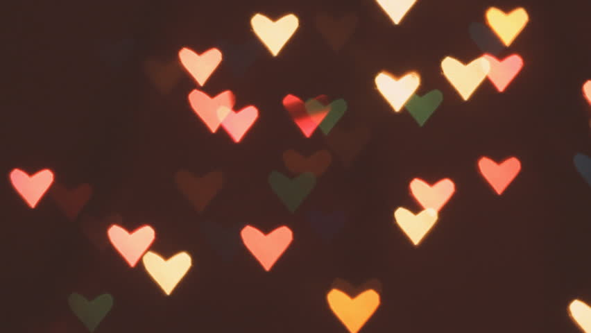 Bokeh Heart Shape Of Light Background Stock Footage Video: Heart Bokeh Background. Valentine's Day Background Stock