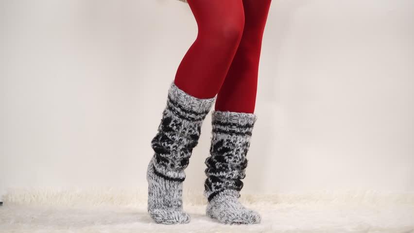 Woman in warm wool socks and pantyhose 4K