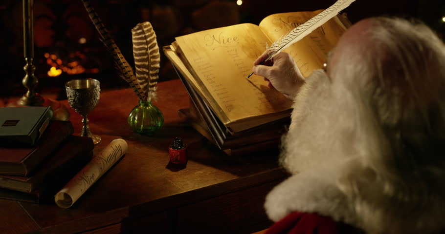 Santa Claus crosses a name off of the Nice list, camera dollies in over his shoulder in 4k