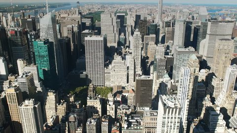 NEW YORK, NEW YORK, USA – SEPTEMBER 15, 2015: zoom out shot of the skyline of upper manhatten in new york