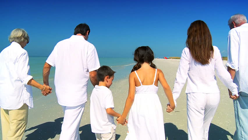 Three generations of a loving family happily walking together on the beach filmed at 60FPS | Shutterstock HD Video #1333849