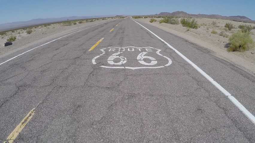 Route 66 Mojave desert highway pavement sign moving shot. | Shutterstock HD Video #13344329