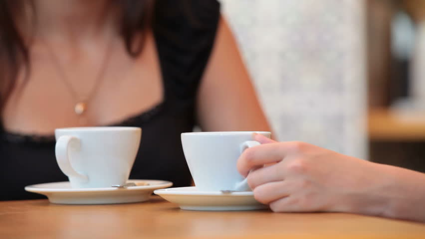 Two girls having coffee in Cafe - HD stock video clip