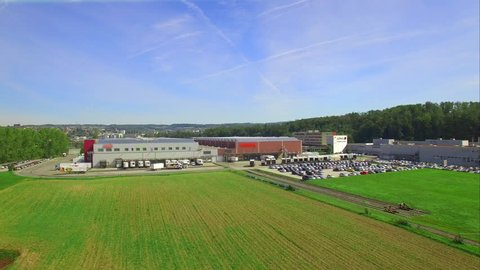 4K aerial shot of a industrial and commercial zone / Supply chain and cars - business & industry