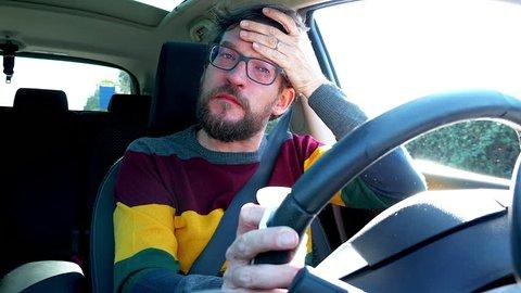 Sick man feeling fever sneezing while driving car 4K