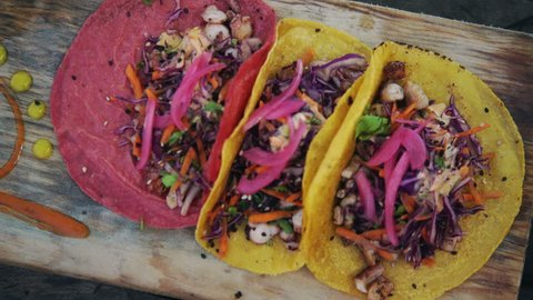 Fresh Octopus Tacos with cabbage, carrots and cilantro served on authentic Mexican Tortillas.