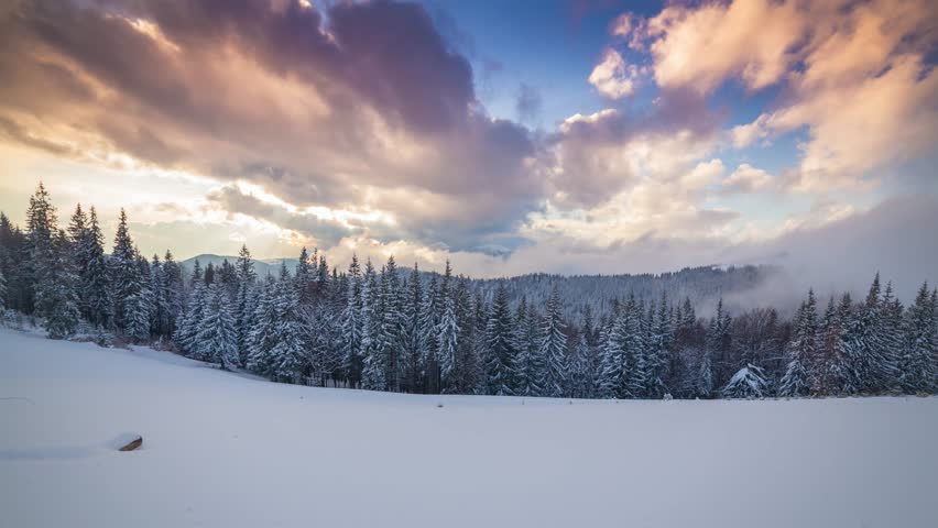Time lapse clip. Colorful winter sunset in the Carpathian mountains, Ukraine, Europe. 4K video (Ultra High Definition). | Shutterstock HD Video #13474139