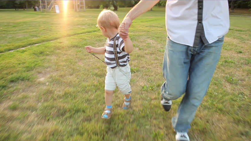 little boy running with toy car