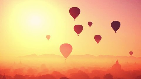 Hot air balloons flying at sunrise over ancient Buddhist Temples at Bagan. Myanmar (Burma) travel landscape and destinations