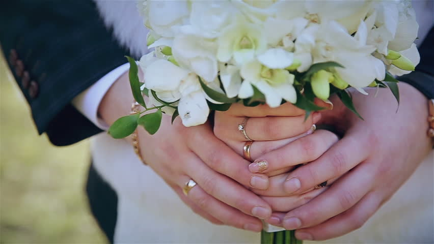 Wedding bouquet in hands of newlyweds | Shutterstock HD Video #13534652
