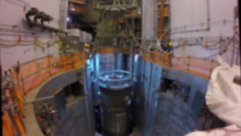 CIRCA 2010s - The core reactor of a nuclear power plant is put into place and fuel rod cells are added.