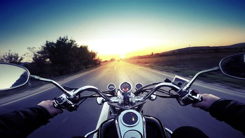 A motorcycle road adventure going forward to the sun in high speed. pov at sunset. VINTAGE