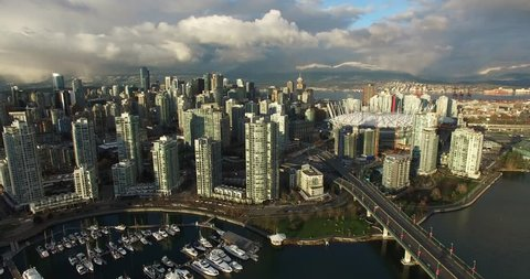 VANCOUVER,CANADA - CIRCA December 2015 :high rising aerial of downtown mountain background