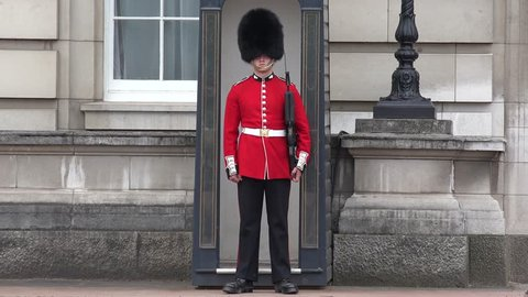 LONDON, JUNE 18, 2015 4K Guarding Buckingham Palace, London, England, Armed British Qeen's Guard