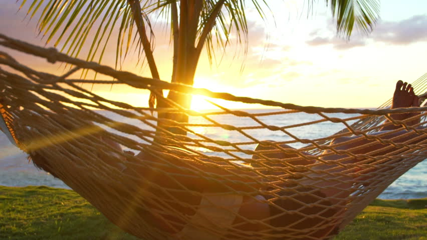 Romantic couple relaxing in tropical hammock at sunset. Summer Luxury Vacation. SLOW MOTION. #13634249