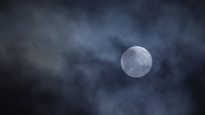 Stock Video Clip Of Full Moon Hiding By The Clouds On