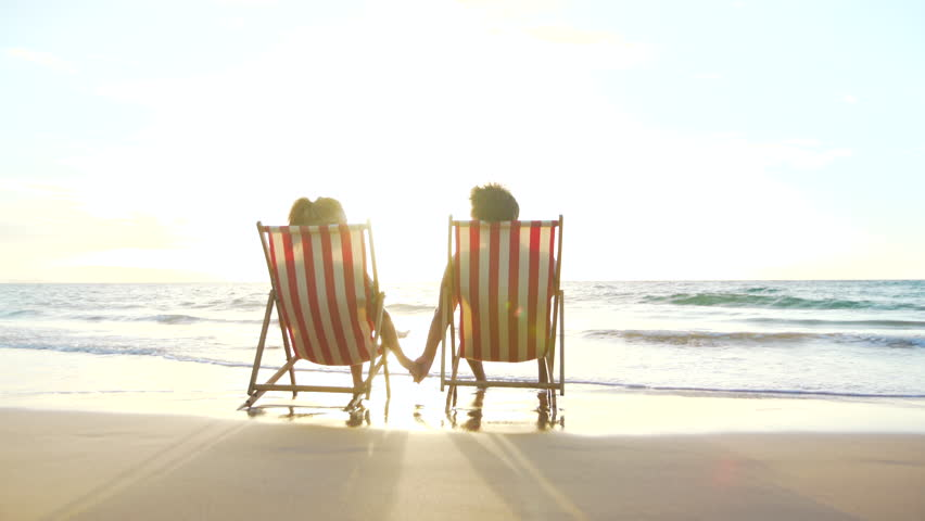 Relaxing Couple On Tropical Resort Luxury Vacation Beach Chairs