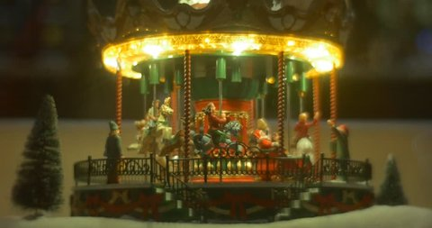 Horses Are Riding Around, riders, men toys, Illuminated Decorative Toy Carousel, Exclusive Toys, small toy fir-trees, New Year Souvenirs, Christmas Showcase in Central Market of Ukraine at Kreschatik