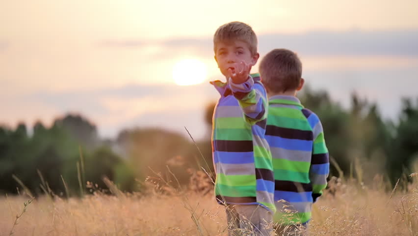 two little boys walking outdoors sunset slow motion hd stock video clip