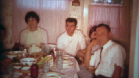 SAN DIEGO, CALIFORNIA 1966: Family crowded into a small kitchen table for a holiday feast to remember.