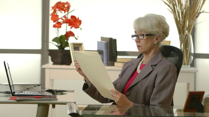 hd00 23an older female ceo or senior executive in her office starts to rh shutterstock com female executive office decor