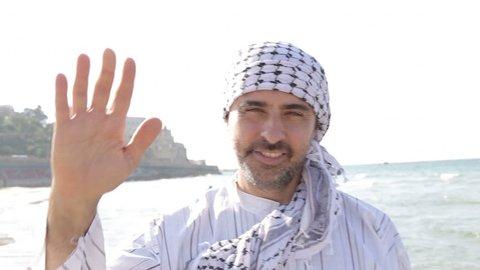 Shot of Arab muslim hello gesture