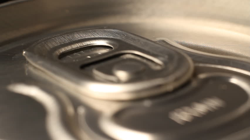 Close up of soda or beer can opening theme sound of opening cans