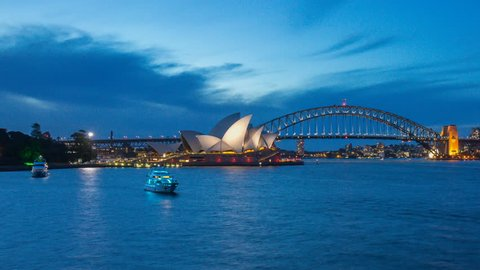 4k footage time lapse of day to night blue hour at Sydney Opera House, view from Royal Botanic Gardens. Panning