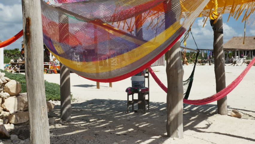 p1070076 beautifully colorful hammocks blowing in wind at beach cabana at playa el mirador cozumel mexico  stock footage video 13838729   shutterstock p1070076 beautifully colorful hammocks blowing in wind at beach      rh   shutterstock