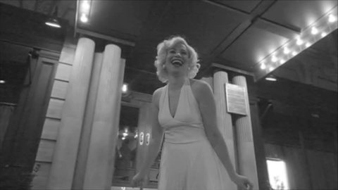 sped-up Marilyn Monroe in black and white in front of hotel laughing from The Seven Year Itch in 1080p HD
