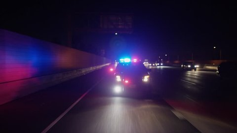 Freeway: Santa Clarita, CA USA Set 5 - Driving Plate Rear View: Car travels S on I-5 on a clear evening in light traffic. State patrol officer pursues car, car pulls off on exit and comes to a stop.