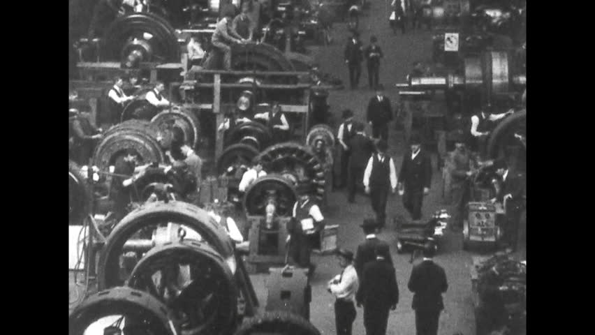 UNITED STATES 1900s: Men Working in a Factory