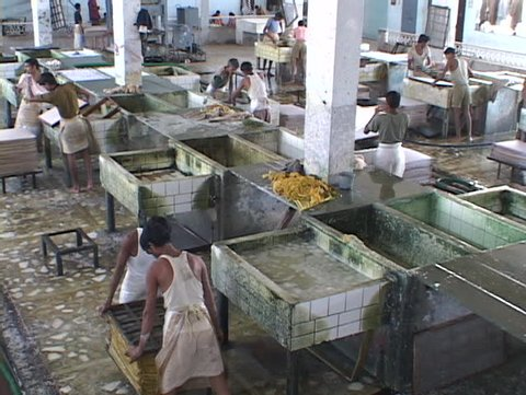 INDIA - CIRCA 2010: Workers mix and blend papers in a factory circa 2010 in India.