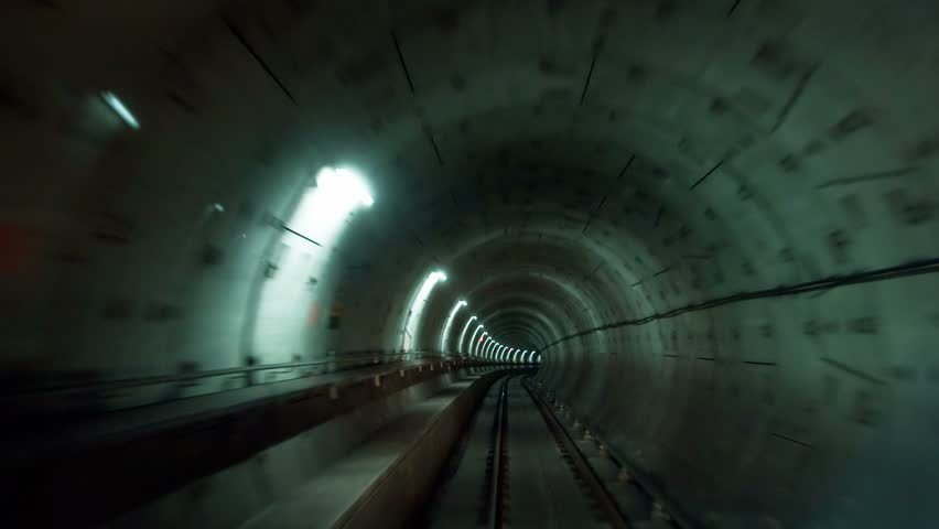 VANCOUVER CANADA - CIRCA JULY 2011: (Timelapse View) Canada Line SkyTrain going through tunnels, circa July 2011, Vancouver, Canada. SkyTrain's 68.7 km (42.7 mi) of track makes it one of the longest automated rapid transit systems in the world. | Shutterstock HD Video #1391239