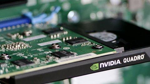 PARIS, FRANCE - CIRCA 2016: Tilt-down to Nvidia Quadro K2200 Professional video card in modern workstation computer