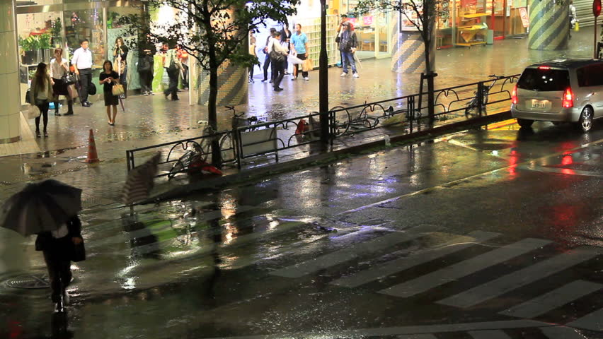 Crosswalk on a street in Tokyo during a typhoon.