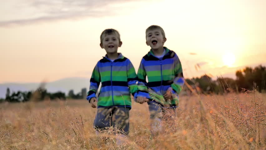 two cute little boys walk nature beautiful countryside grass meadow sunset slow motion hd stock - Pictures For Little Boys