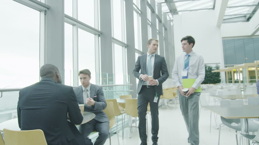 4k / Ultra HD version Business people take a break in the company canteen of a large contemporary office building. Shot on RED Epic | Shutterstock HD Video #13951229