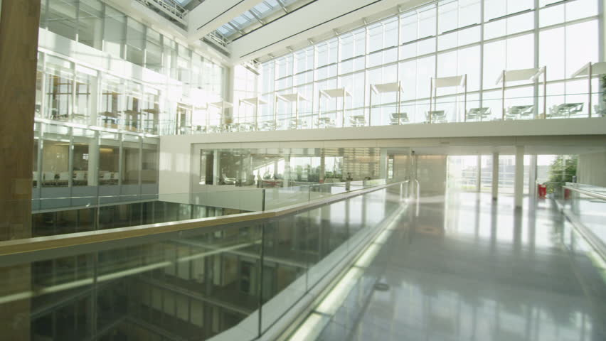 4k / Ultra HD version Interior view of a large contemporary office building with glass partitions and large central atrium. No people. Shot on RED Epic