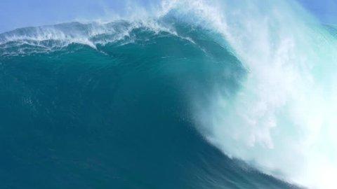 Giant Ocean Wave Breaking in Hawaii. Slow Motion HD. Surfing Jaws