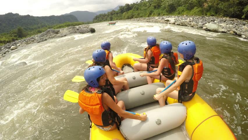 Group Of Young Sexy Girls Wearing Bikini Having Fun On Extreme White Water Rafting Trip Onboard Camera