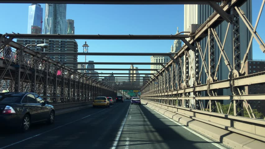 New York City - United States, October 2015: Traffic on Brooklyn Bridge in a sunny day | Shutterstock HD Video #14017199