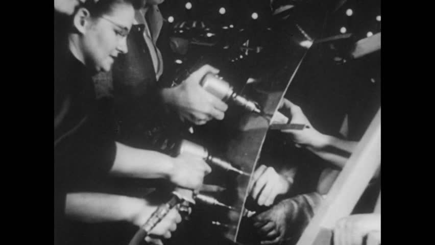 Employees working in munitions factory, 1940s