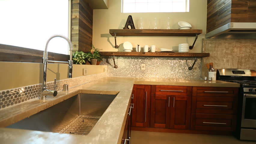 Modern Kitchen Sink Panning Right. Camera Moves Away From A Close Up Of A  Modern