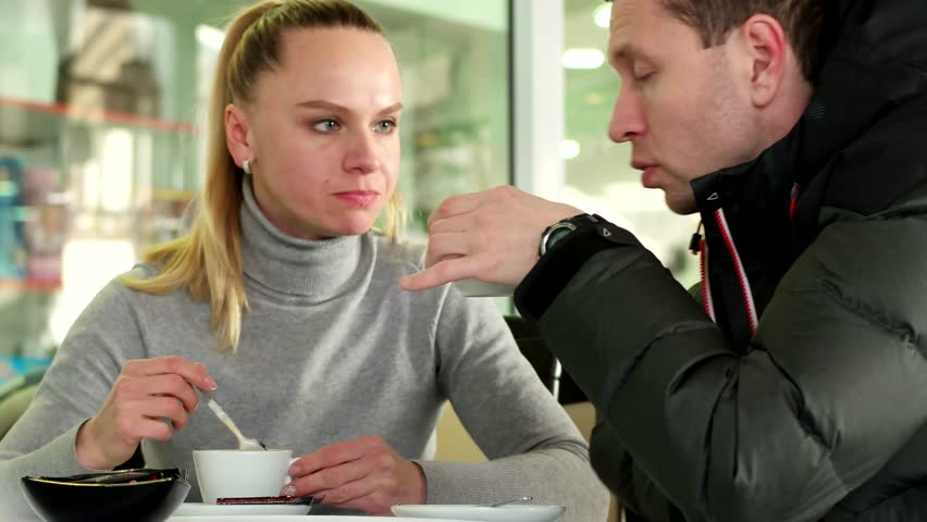 The young couple talking and laughing in the Cafe   Shutterstock HD Video #14037569