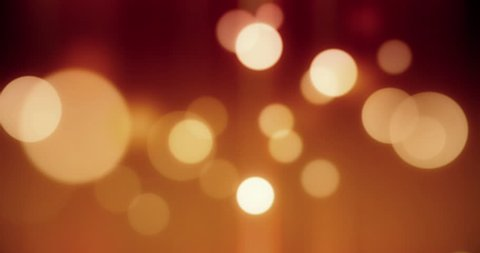 Gold bokeh lights in motion in 4 K. High quality render of gold particles. Ideal for Christmas, valentine`s day, wedding, love, celebration and party videos as background.